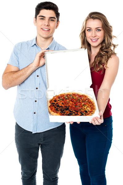 Nyami pizza fiatal pér felajánlás finom nő Stock fotó © stockyimages