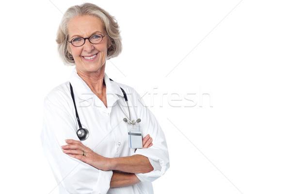 Experienced lady doctor with stethoscope Stock photo © stockyimages