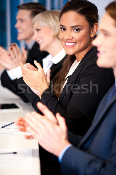 Business team of four applauding Stock photo © stockyimages