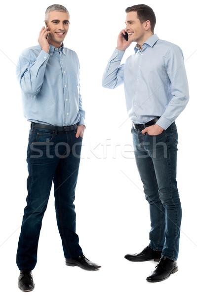 2 若い男性 話し 携帯電話 ビジネスの方々 ストックフォト © stockyimages