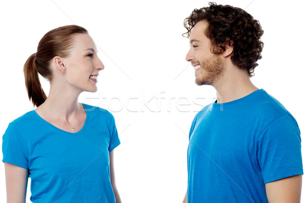 Happy young couple posing casually Stock photo © stockyimages