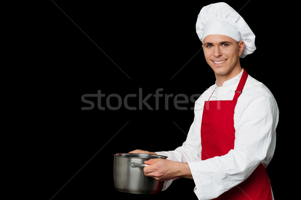 Male chef holding empty vessels Stock photo © stockyimages
