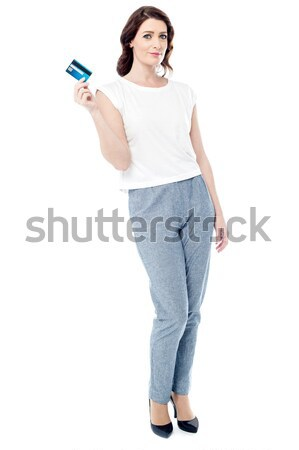 Attractive woman displaying her credit card Stock photo © stockyimages