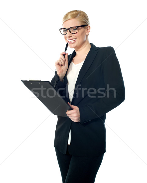 Smiling mischievous female business executive Stock photo © stockyimages
