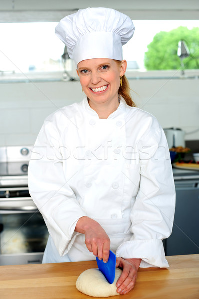 Female chef kneading bread dough Stock photo © stockyimages