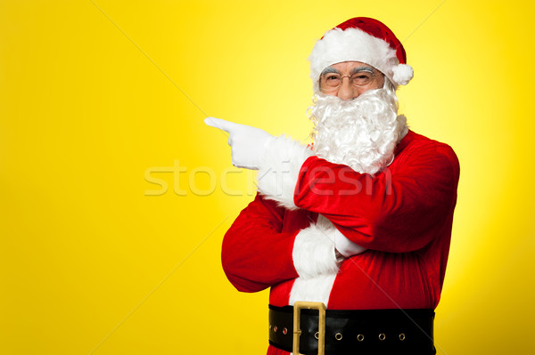 Kris Kringle gesturing towards the copy space area Stock photo © stockyimages
