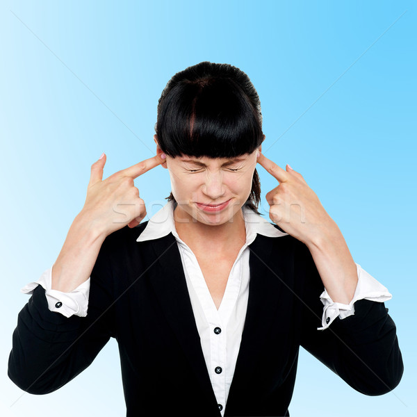 Stock photo: Female employee covering her ears