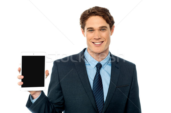 Young man showing newly launched tablet device Stock photo © stockyimages