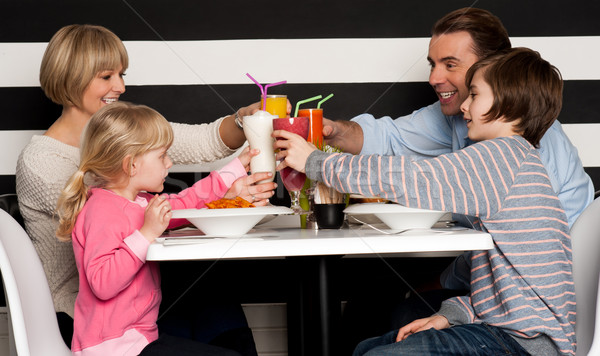 Family toasting smoothies in restaurant Stock photo © stockyimages