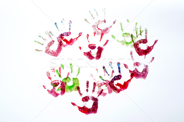 Multicoloured painted hand prints isolated on white Stock photo © stockyimages