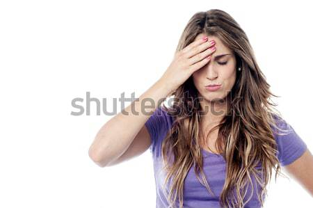 Tensed woman touching her head Stock photo © stockyimages