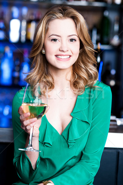 Pretty woman with aperitif. Stock photo © stockyimages