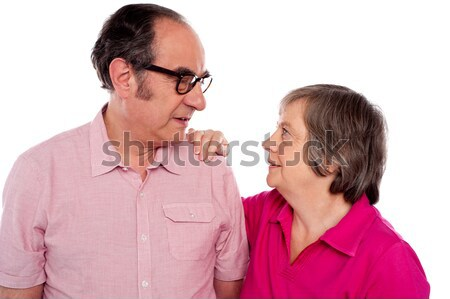 Looking into each others eyes. Aged love couple Stock photo © stockyimages