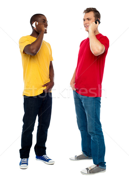 Trendy handsome guys attending call on cellphone Stock photo © stockyimages
