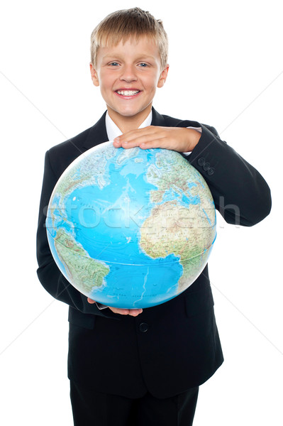 Cheerful boy in suit holding globe with both hands Stock photo © stockyimages
