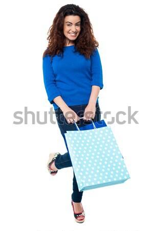 Tempo shopping 2013 eccitato donna Foto d'archivio © stockyimages