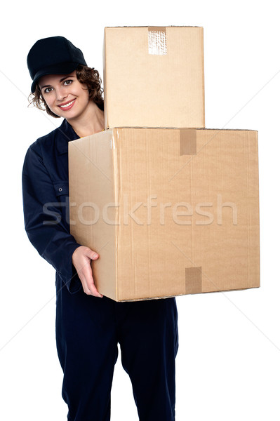 Friendly delivery woman at your doorstep Stock photo © stockyimages