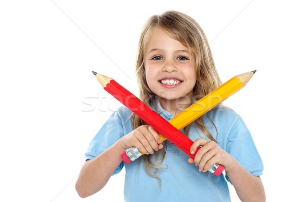 Charming school girl posing with big pencils Stock photo © stockyimages
