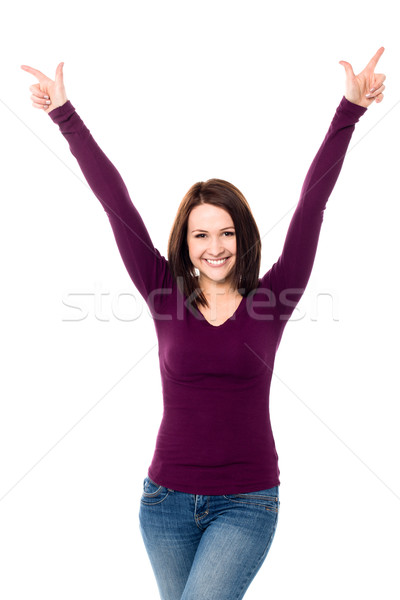 Victorious young woman celebrating her success Stock photo © stockyimages