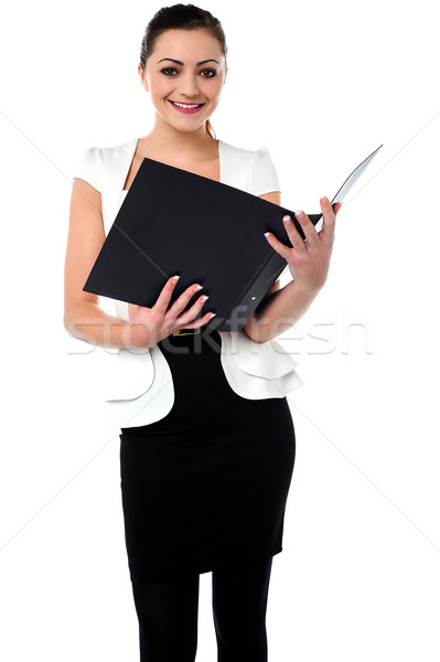 Female secretary reviewing companys file Stock photo © stockyimages
