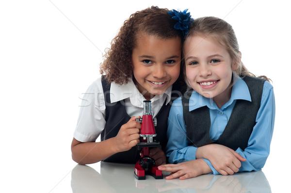 Jovem pequeno escolas meninas microscópio ciência Foto stock © stockyimages