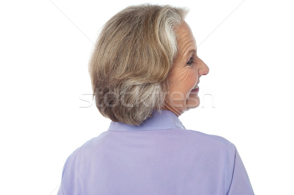 Back pose of an old lady  Stock photo © stockyimages