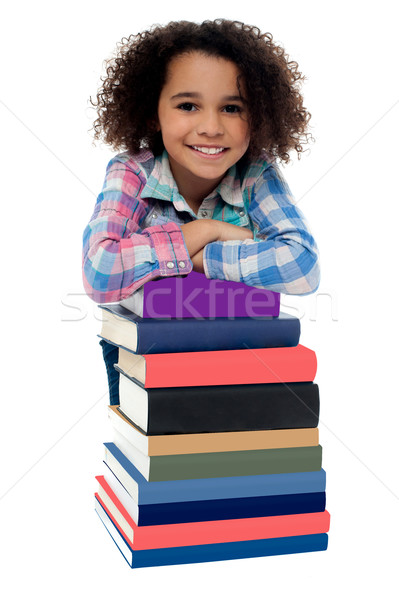 Smiling kid isolated over white Stock photo © stockyimages