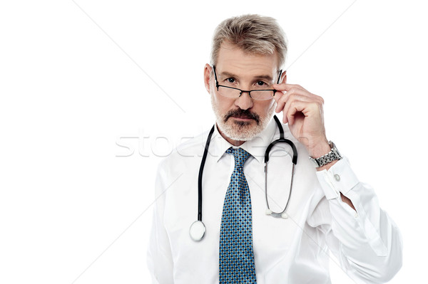 Experienced male doctor isolated over white Stock photo © stockyimages