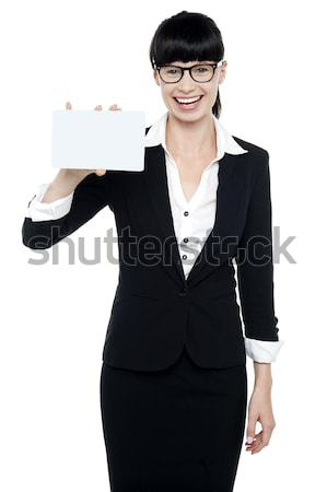 Attractive femaleholding business documents Stock photo © stockyimages