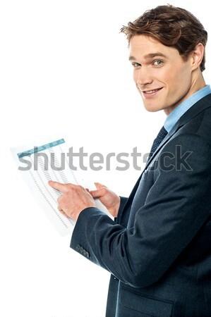 üzlet igazgató olvas szöveg sms mobiltelefon Stock fotó © stockyimages