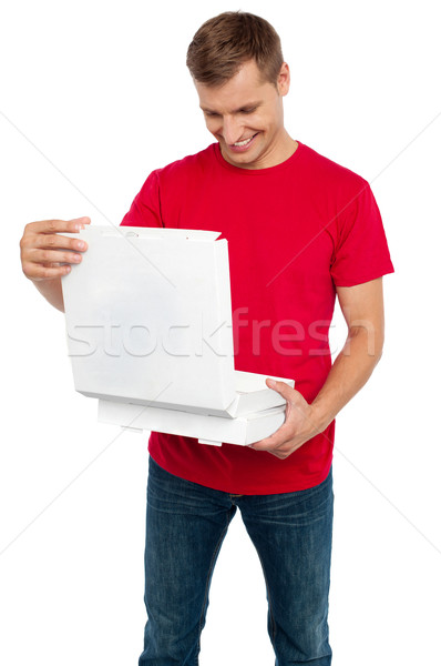 Faminto homem olhando delicioso pizza Foto stock © stockyimages