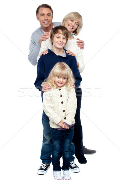 Affectionate family of four standing in a row Stock photo © stockyimages