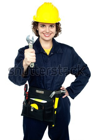 Relaxed construction worker with yellow helmet Stock photo © stockyimages