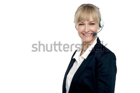 Corporate telecaller smiling confidently Stock photo © stockyimages