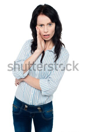 Amazed young woman Stock photo © stockyimages