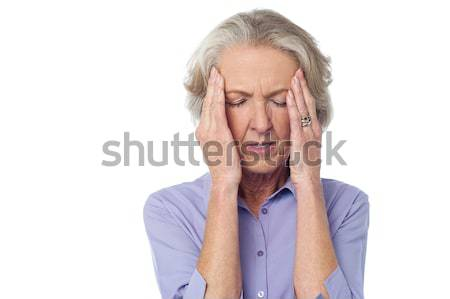 Old lady suffering from headache Stock photo © stockyimages