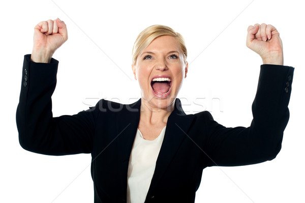 Corporate lady shouting with arms up Stock photo © stockyimages