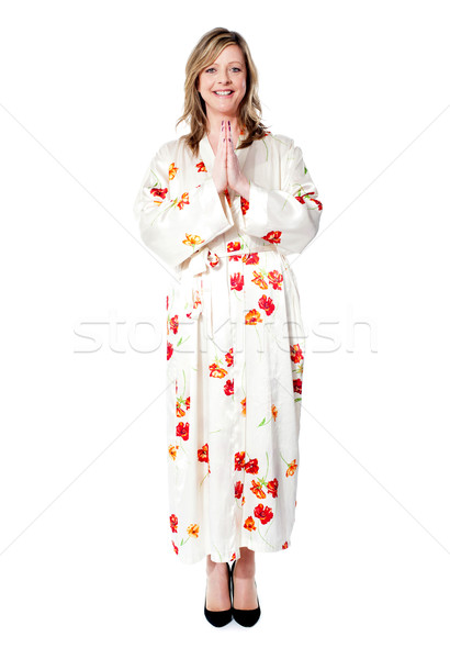 Full length shot of woman welcoming you Stock photo © stockyimages