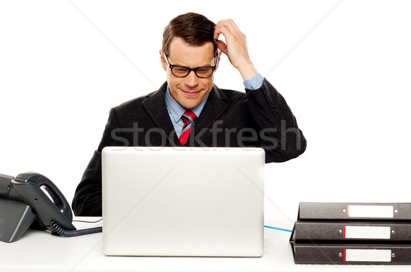 Confused male manager itching his head Stock photo © stockyimages