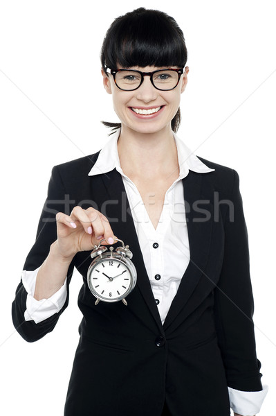 Smiling young lady holding old fashioned time piece Stock photo © stockyimages