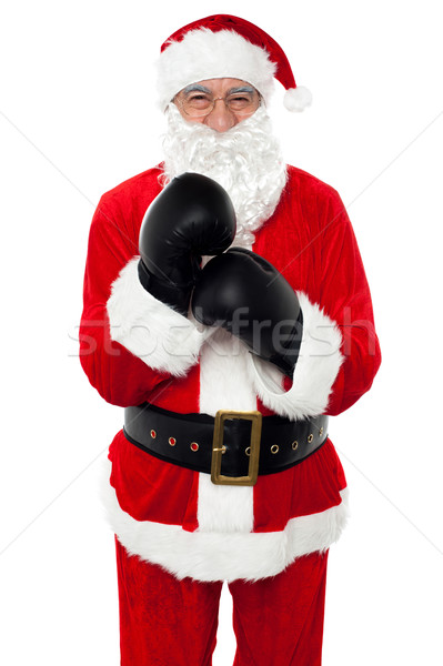 Aged cheerful Santa wearing boxing gloves Stock photo © stockyimages