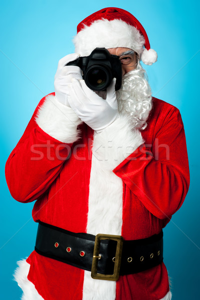 Santa Claus turns into a pro photographer Stock photo © stockyimages