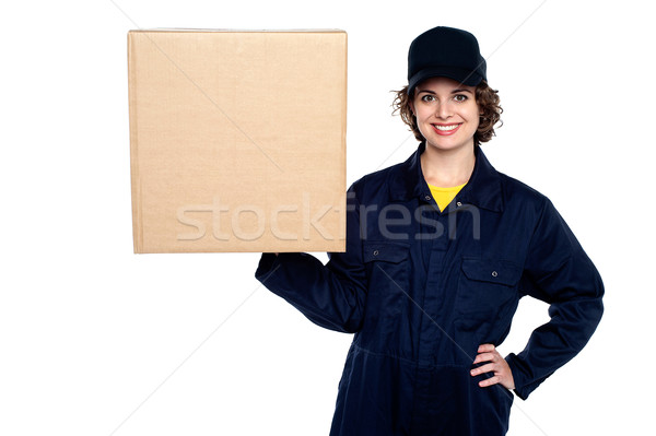 Delivery woman balancing a sealed carton Stock photo © stockyimages