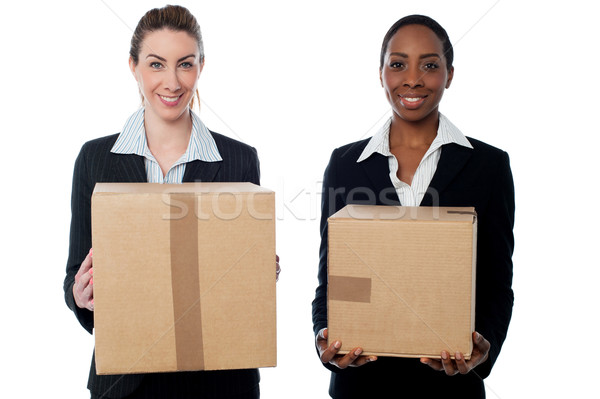 Businesswomen holding packed cartons Stock photo © stockyimages