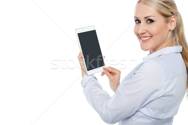 Pretty female working on touch pad Stock photo © stockyimages