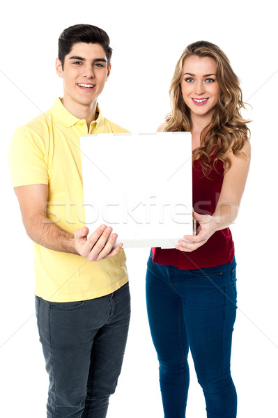 Young love couple with pizza box Stock photo © stockyimages