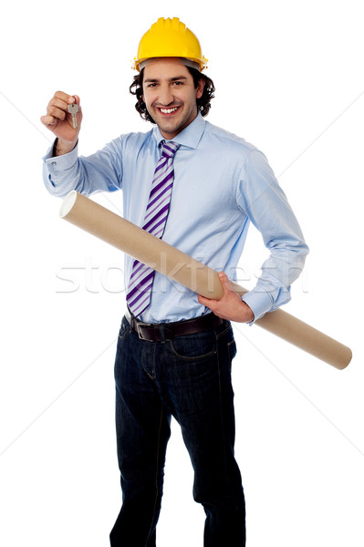 Young engineer with key and blueprint  Stock photo © stockyimages
