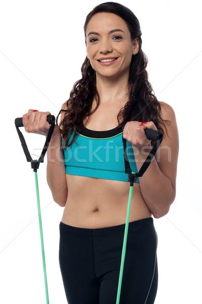 Mujer resistencia banda deportivo ejercicio Foto stock © stockyimages