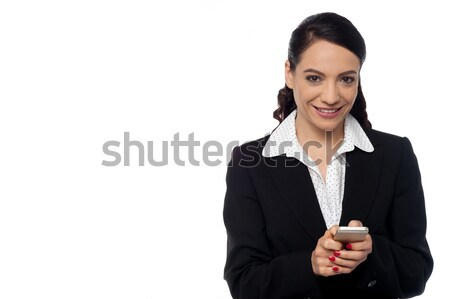 Happy corporate woman with android phone Stock photo © stockyimages