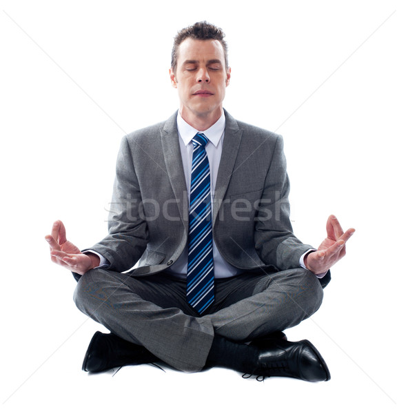 Businessman meditating in lotus position Stock photo © stockyimages